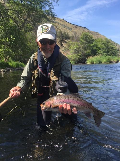 Phillip Dean with a well-fed Deschutes rainbow that pounced on a Norm Woods Special.